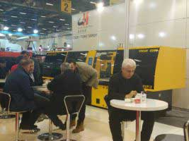 People discussed around the injection molding machine.