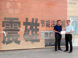 The winner in the front the factory at ChinaPlas 2015 Grand Lucky Draw