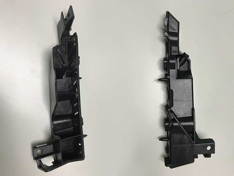 Automotive components - left and right upper brackets are produced by EM320-SVP/2 Injection Molding Machine